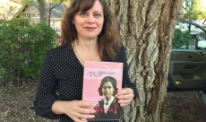 April Young Bennett with her book, Ask a Suffragist