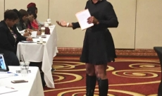 Speaking at a conference on business and managing finances